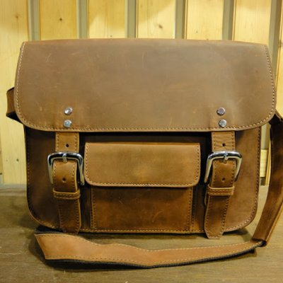 https://www.skullnroses.net/wp-content/uploads/2015/02/MB-3463-front-2-brown-messenger-bag.jpg