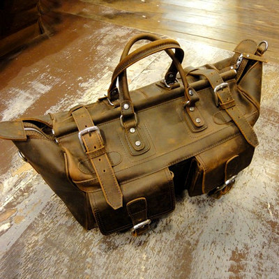 https://www.skullnroses.net/wp-content/uploads/2015/02/warrior-bag_full-grain-front.jpg